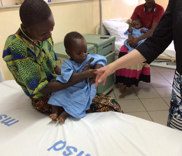 Baby Joshua on his mother's lap. Picture: DFID