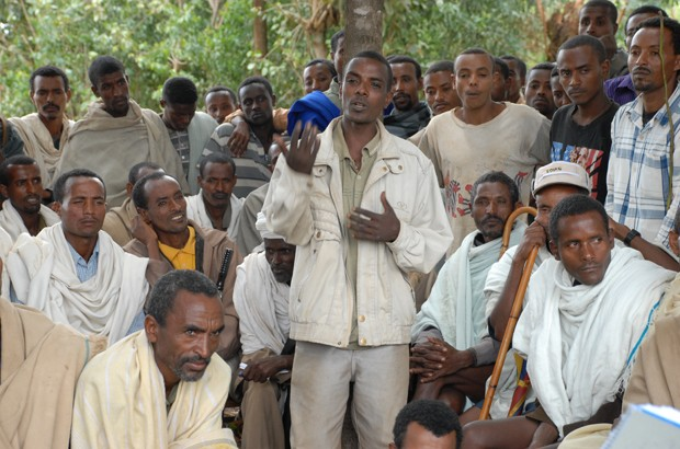 Men in a rural village in Amhara, Ethiopia, discuss gender equality on a course run by the Population Council. Picture: Ashenafi Tibebe/Girls Not Brides. All rights reserved.