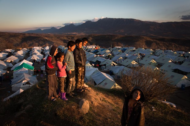 Children look out at the sunset over the Bamarne IDP camp in northern Iraq. Picture: Andrew McConnell/Panos for DFID