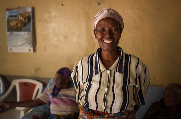 Anne lives in Kenya's Central Province. She is 65 years old and looks after 8 grandchildren and mother-in-law and works as a HIV peer educator. Picture: Phil Moore/Age International.